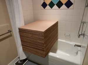 stack of cardboard spanning the bathtub