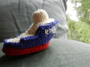 a knitted toy ship modeled after the research vessel Knorr